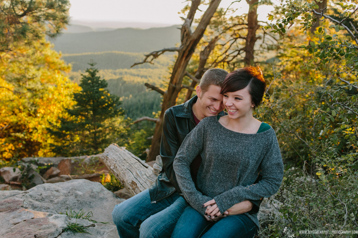 laughing couple at Mogollon Rim Arizona in fall by Mesa engagement photographer Alyssa Campbell
