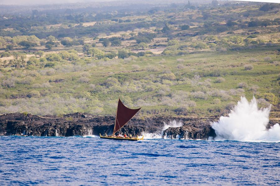 Hawaiian Polynesian boat along rocky coastline