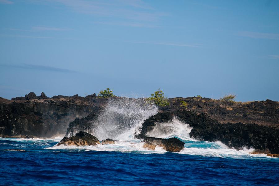 waves hitting rocky Hawaiian western coastline