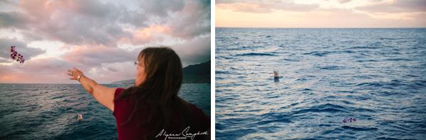 throwing a lei into the ocean memorial at sea