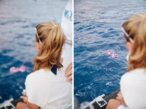 releasing a lei into the ocean