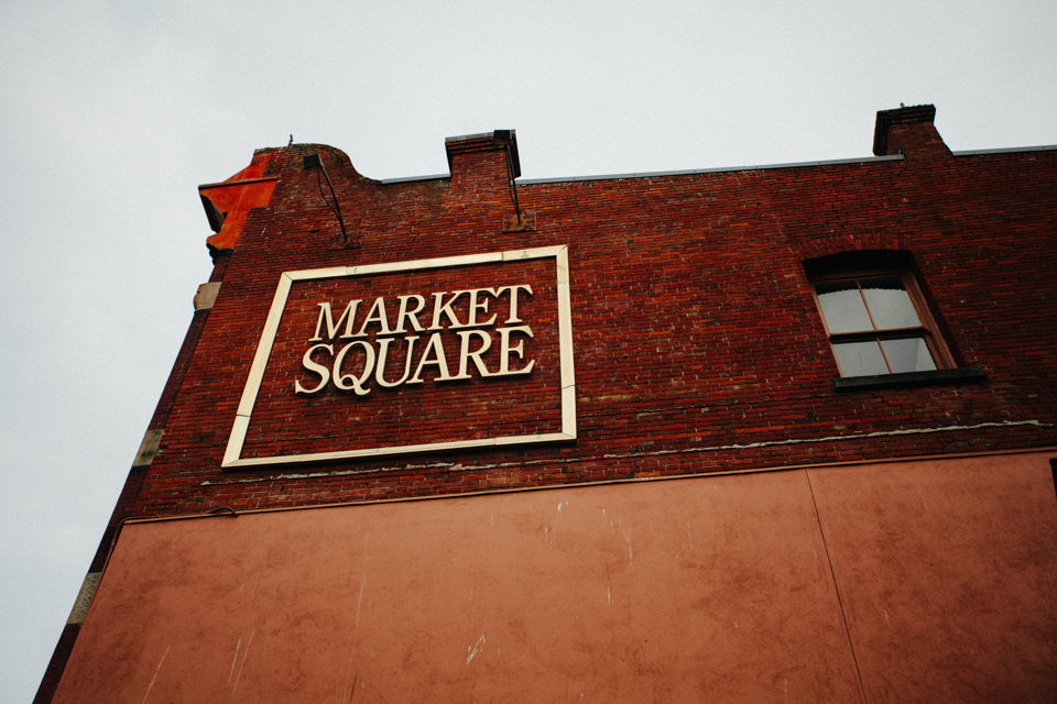 market square sign on the side of a brick building in Victoria BC