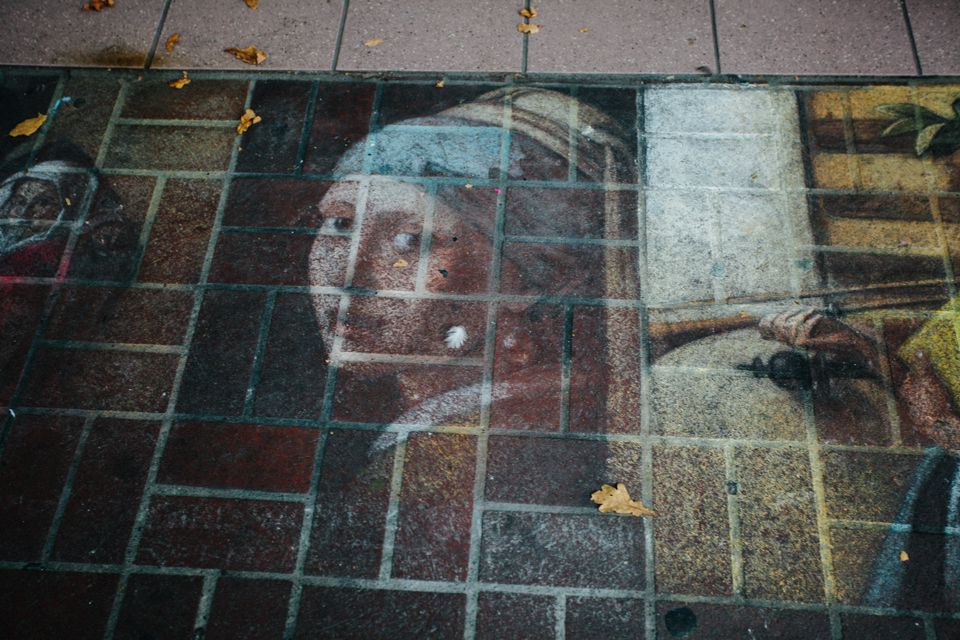 girl with a pearl earring chalk painting on sidewalk