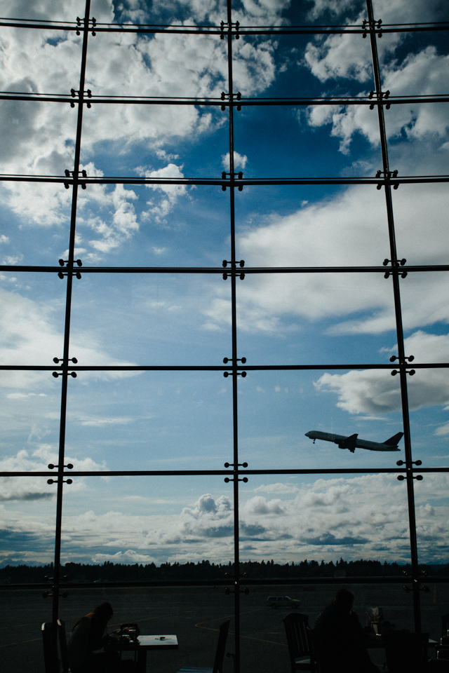 Seatttle Sea-tac airport food court window with plane taking off