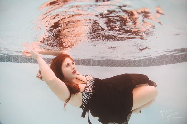 photo of arizona high school senior underwater prom dress session