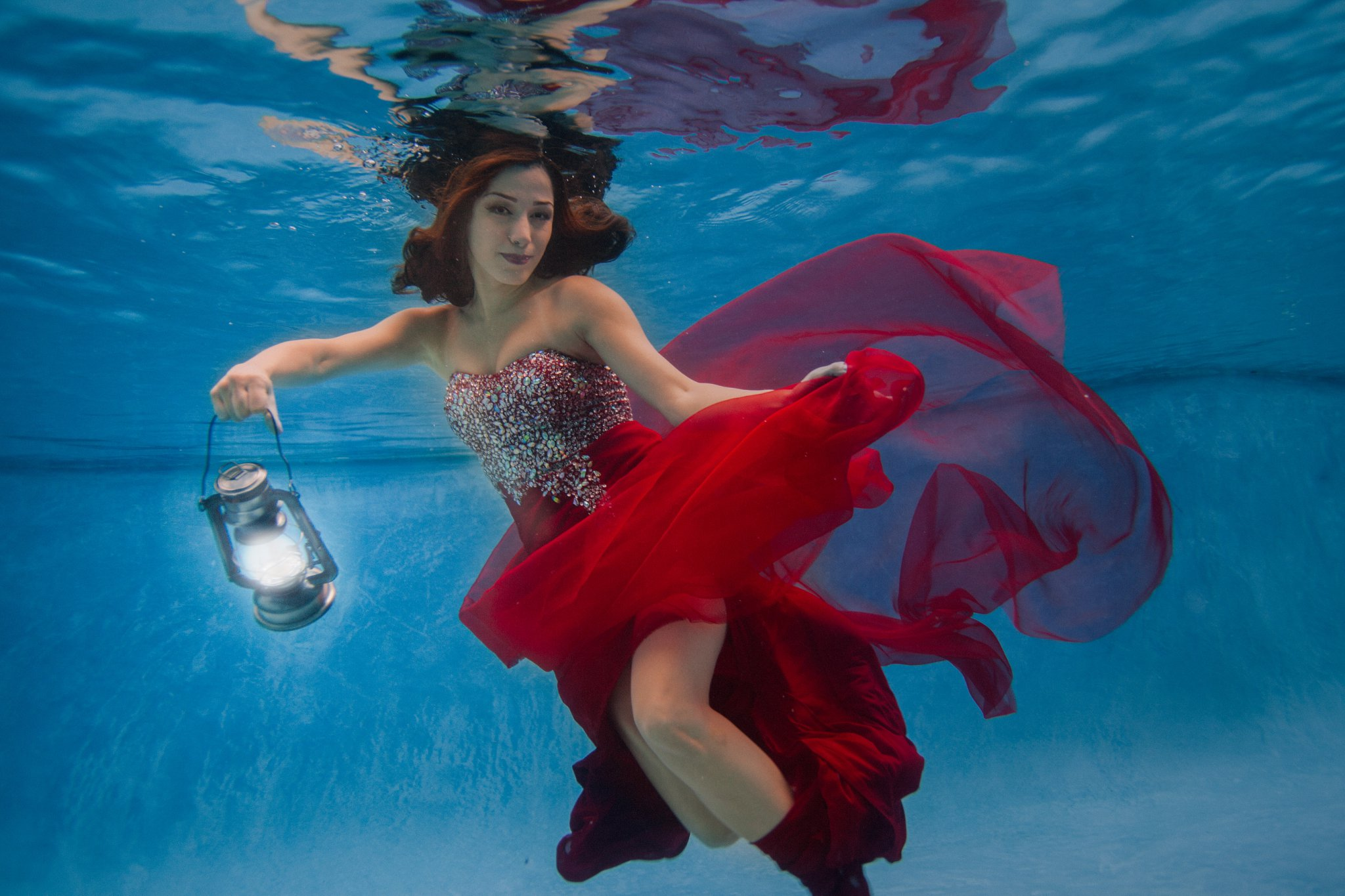 woman in red dress underwater fashion photos