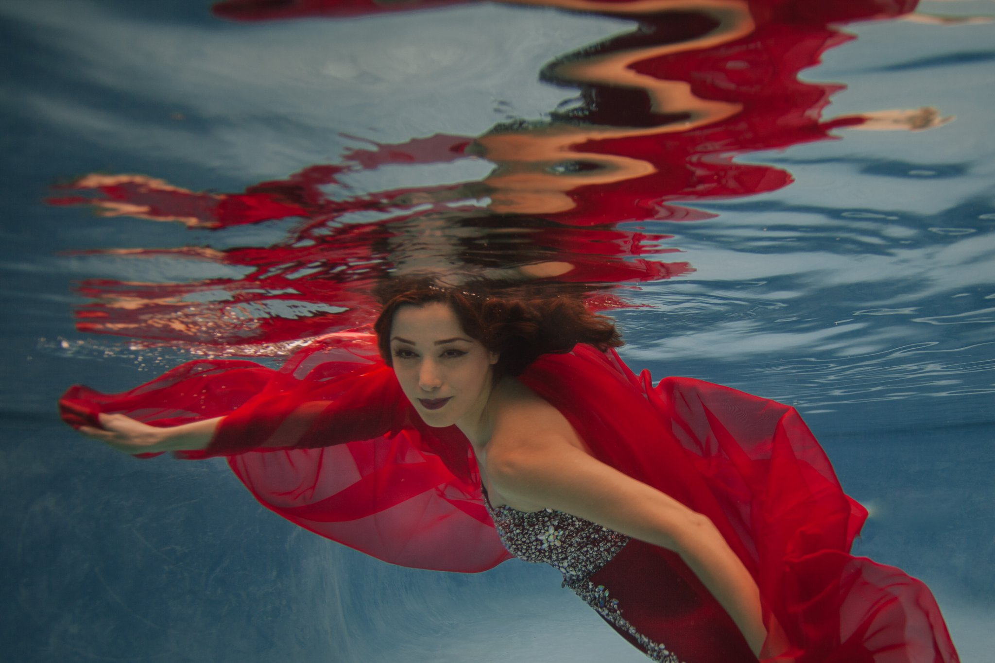 girl in a red dress underwater portraits by Phoenix underwater photographer Alyssa Campbell