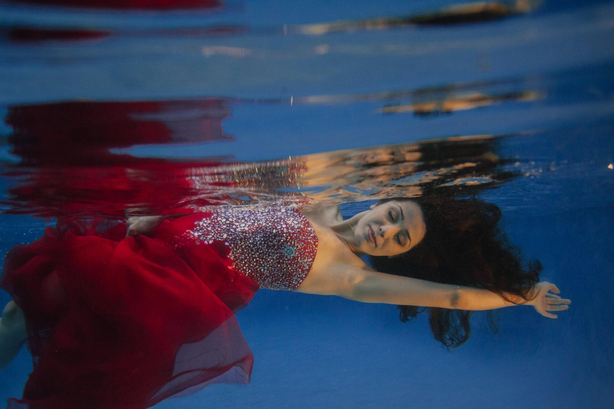 Phoenix underwater fashion photos in red dress