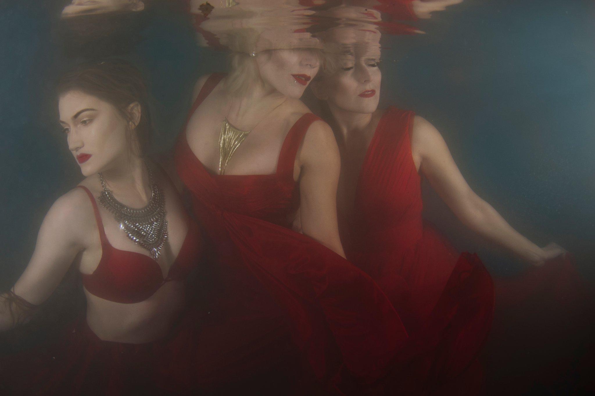 underwater ladies in red dresses