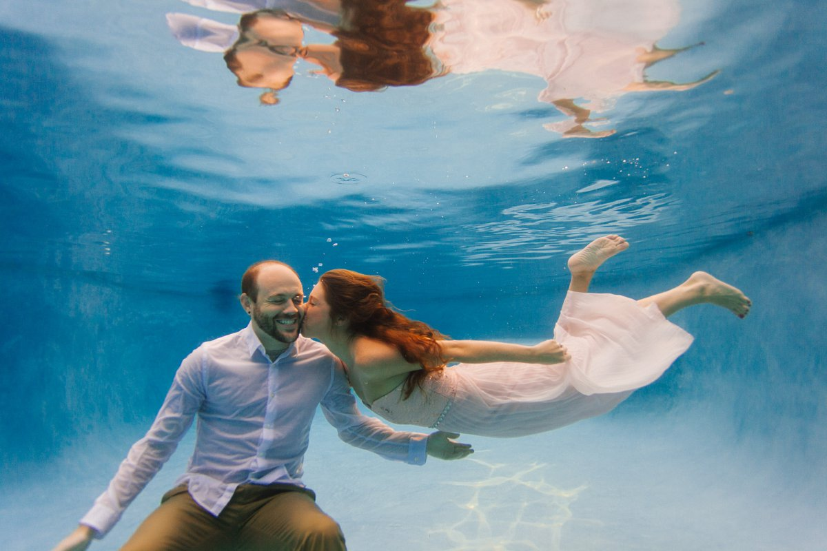 underwater engagement photos in a pool Phoenix AZ