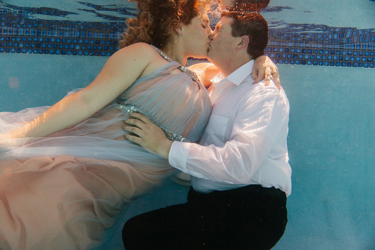 unique underwater engagement photos in Scottsdale by Arizona underwater photographer Alyssa Campbell Photography