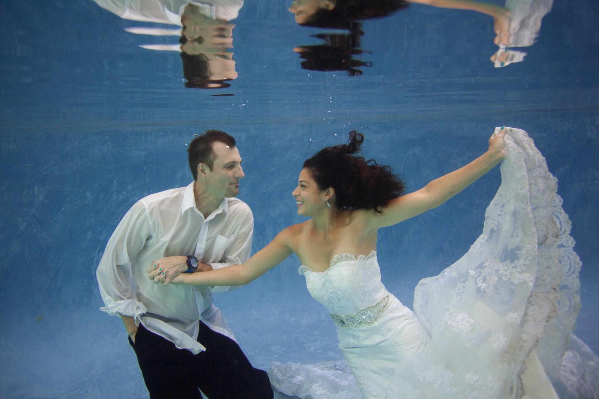 underwater trash the wedding dress photos in a pool Phoenix, AZ