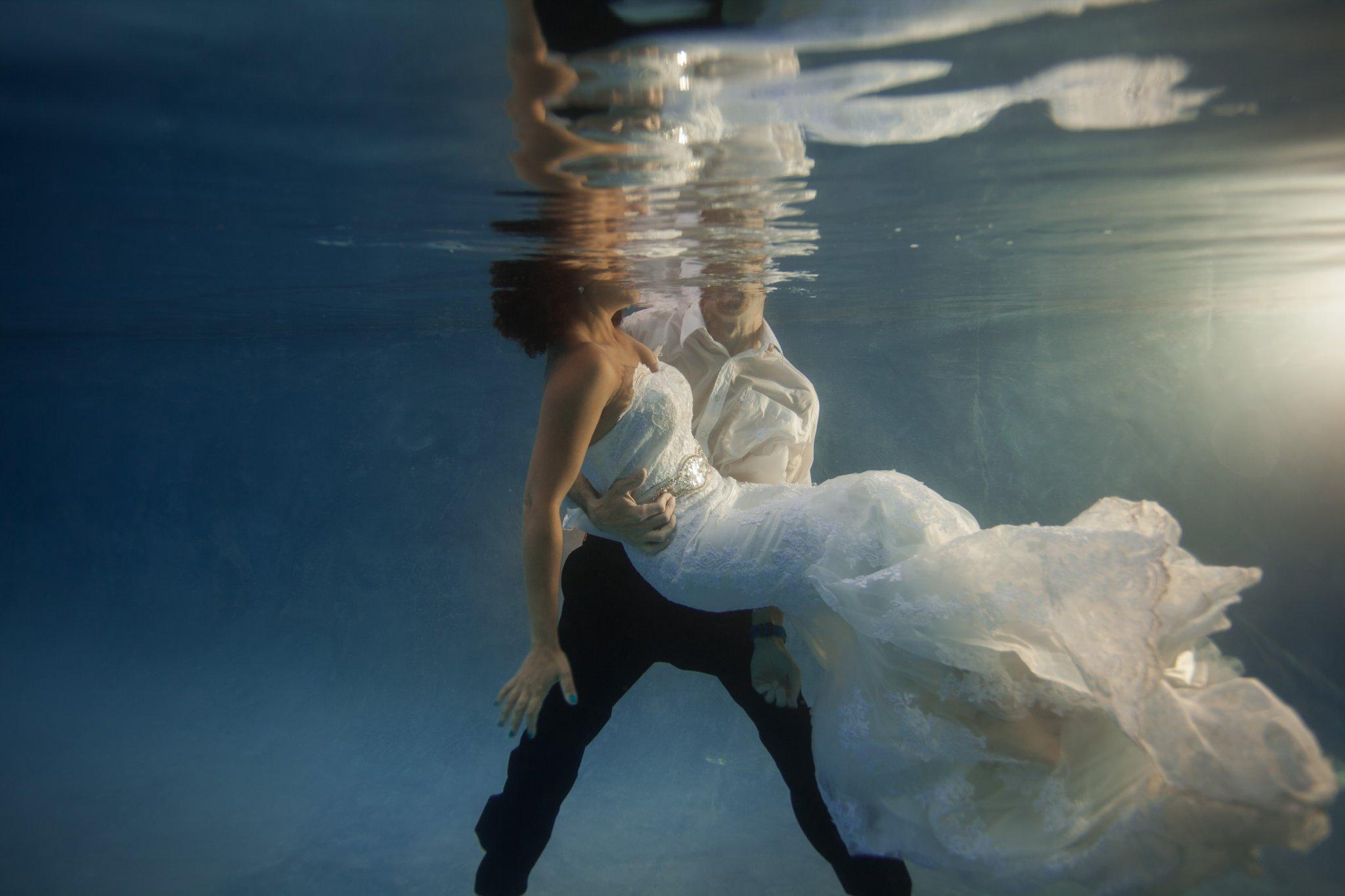 underwater trash the dress photos by Arizona wedding photographer