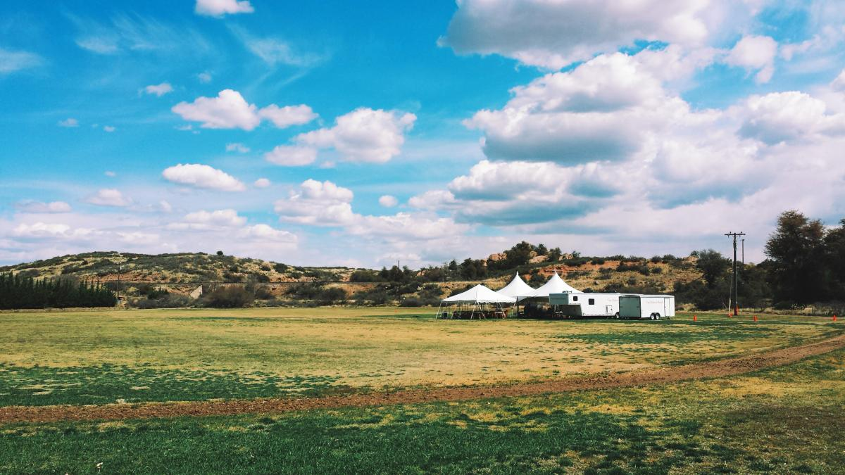 open field wedding venue with tents in Skull Valley, Arizona