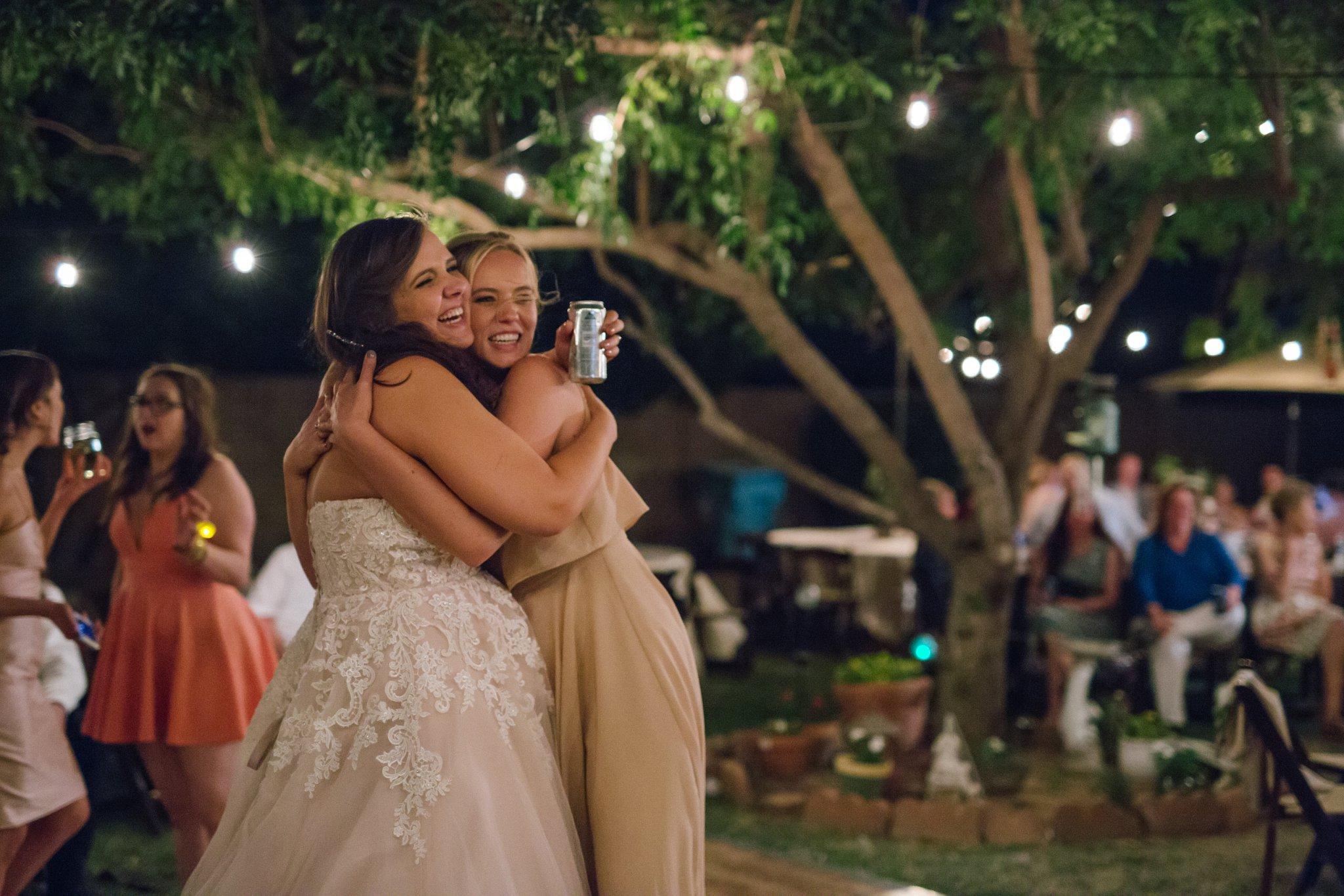 backyard Phoenix wedding reception by candid documentary Phoenix wedding photographer