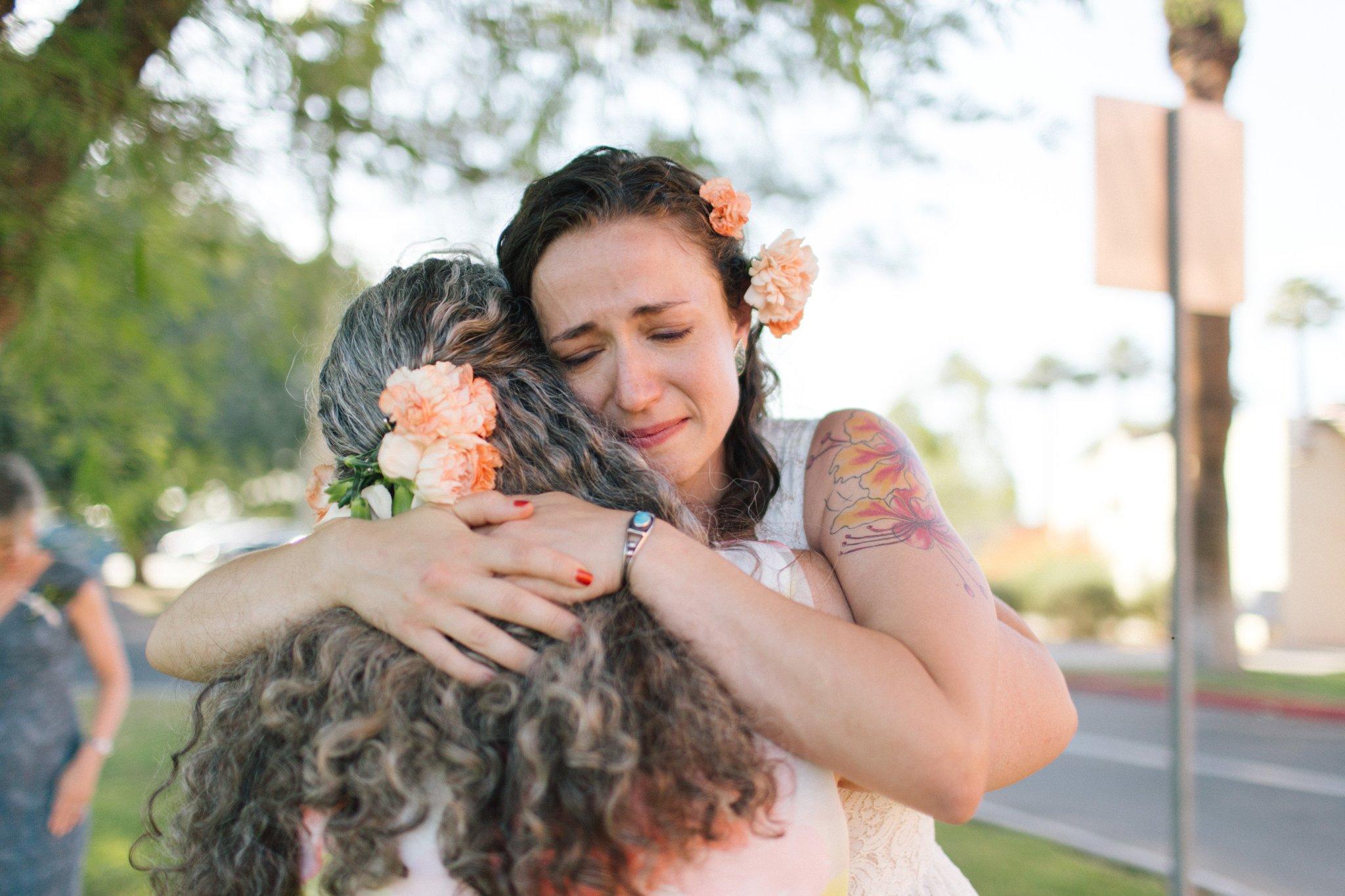 Encanto Park wedding emotional hug