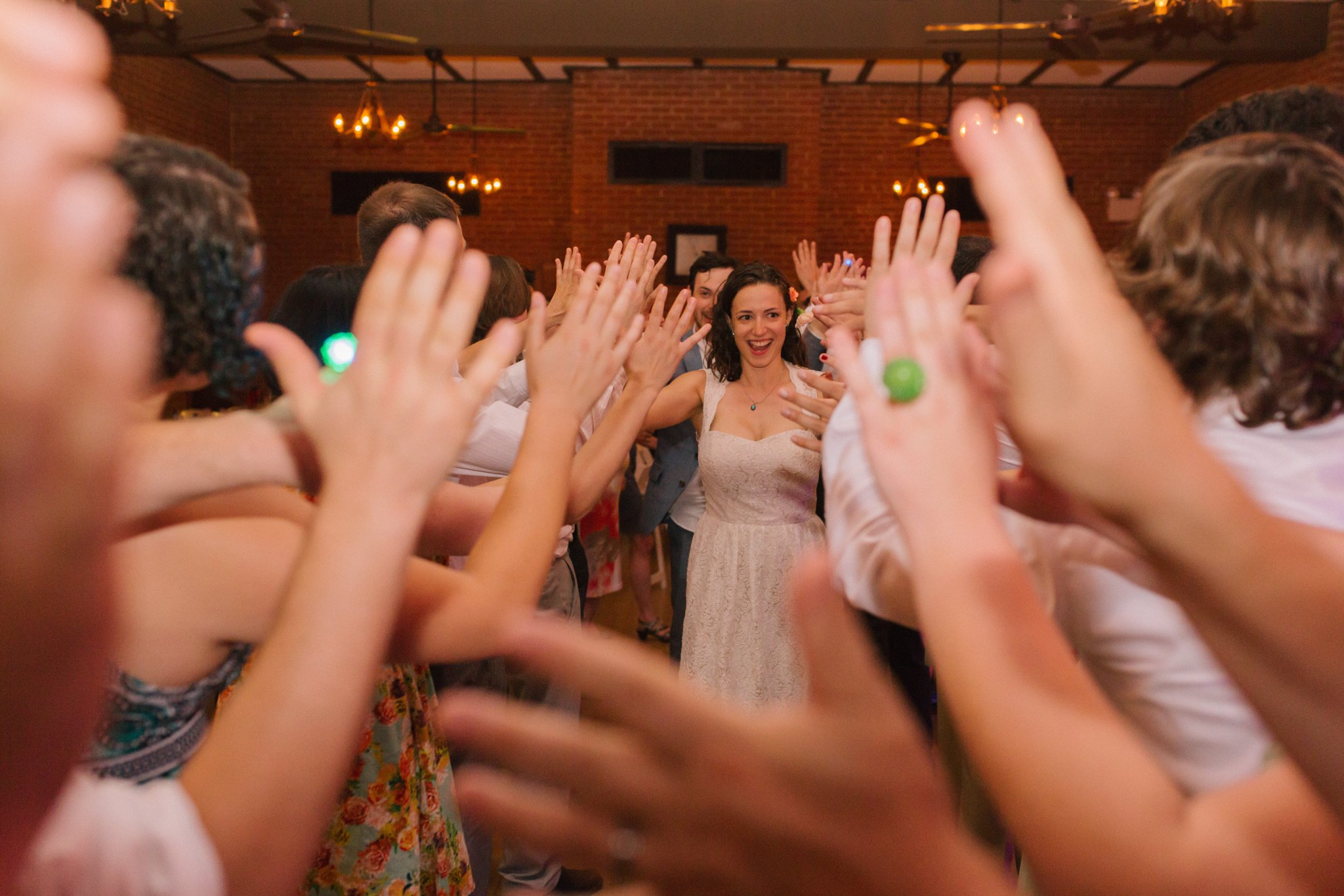 Encanto Park wedding reception tunnel of high fives wedding exit