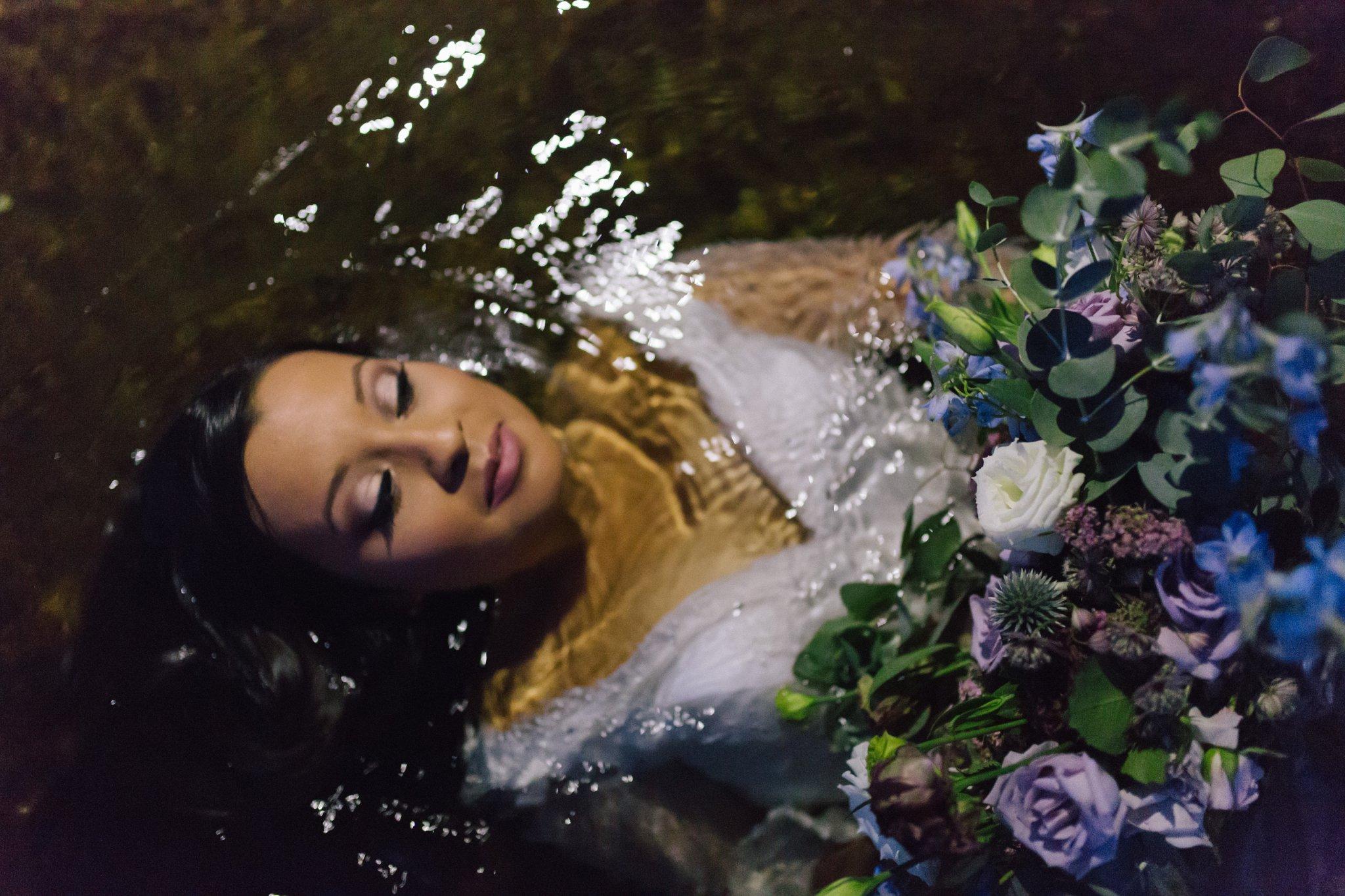 adventurous bride in Salt River in the water
