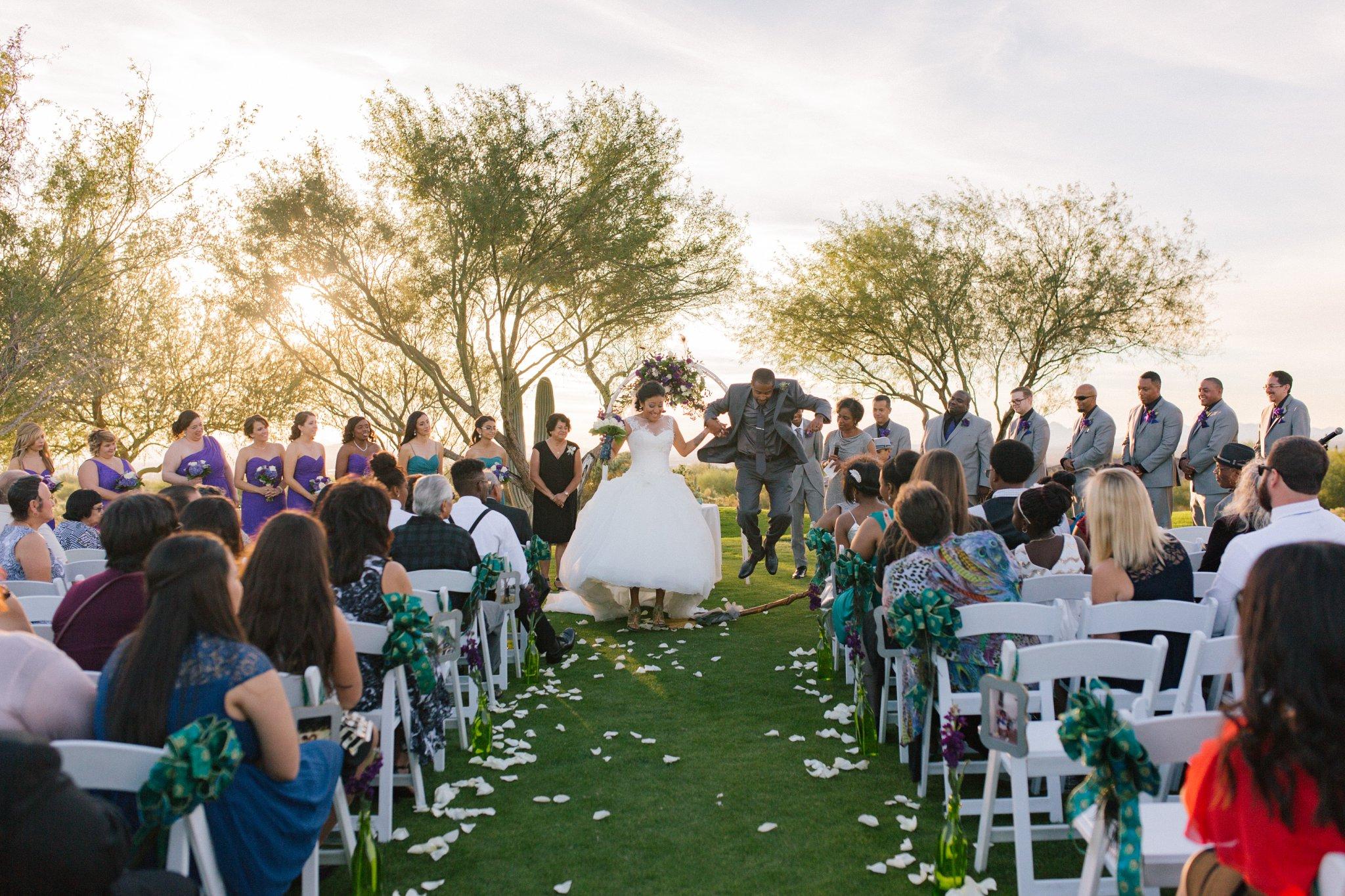 Las Sendas golf course wedding ceremony bride & groom jumping over the broom