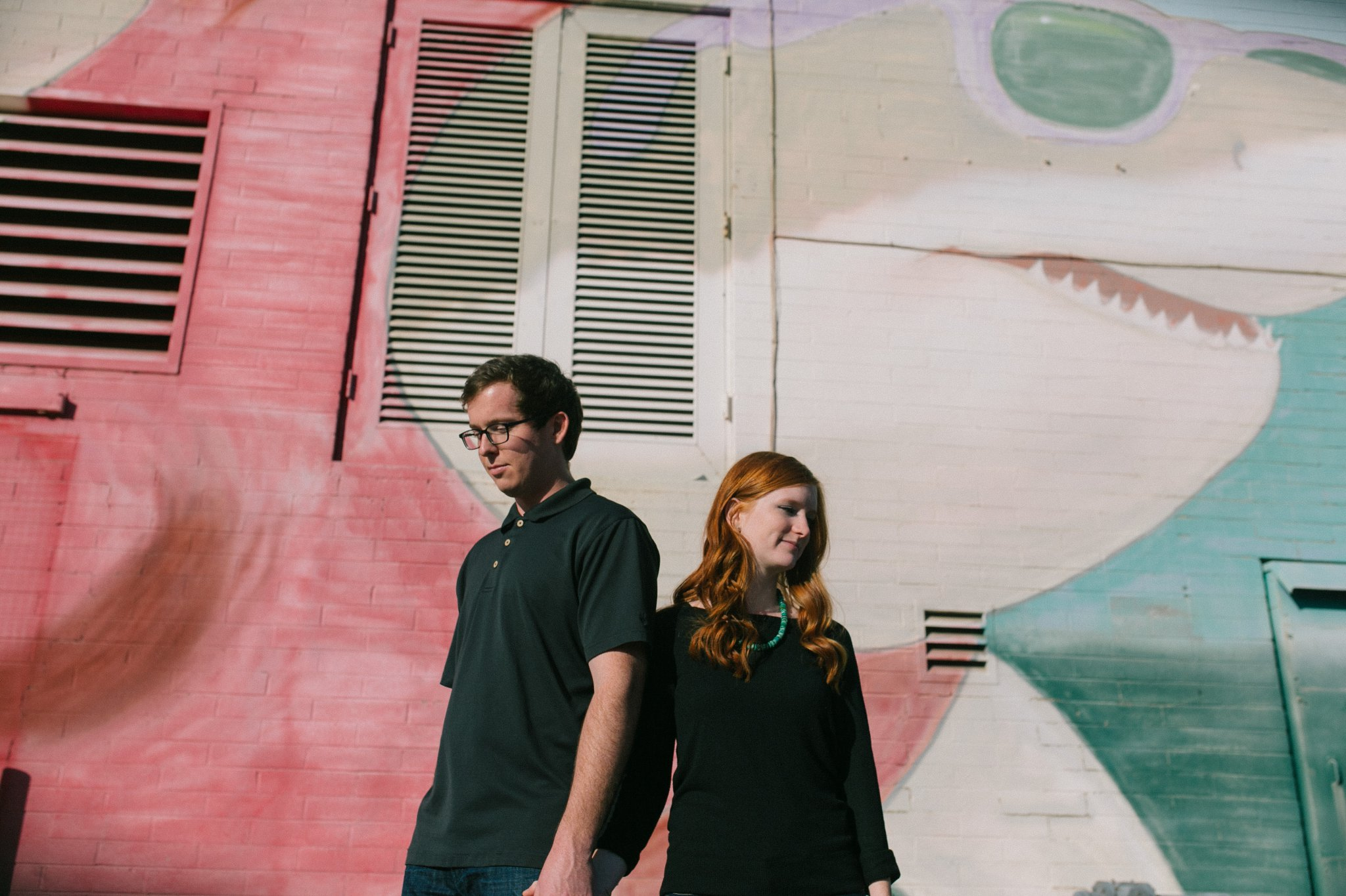 downtown urban Mesa engagement photos in front of shark mural