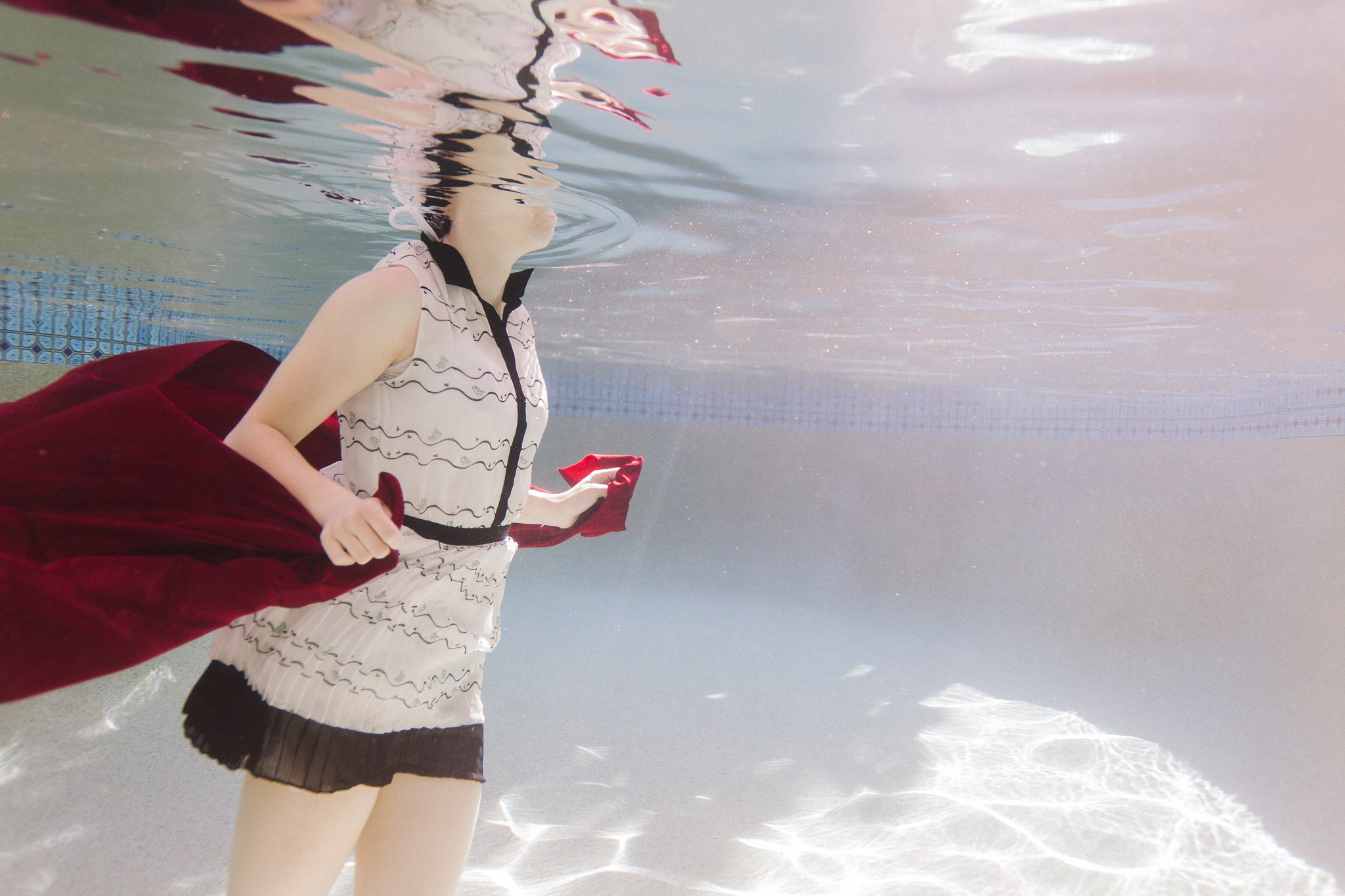 artistic underwater portraits in a pool in Phoenix