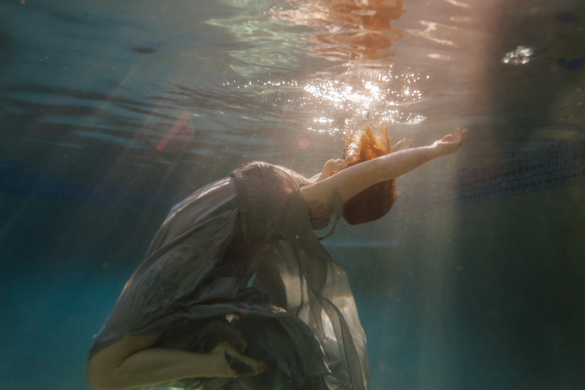 artistic underwater portraits in a dress