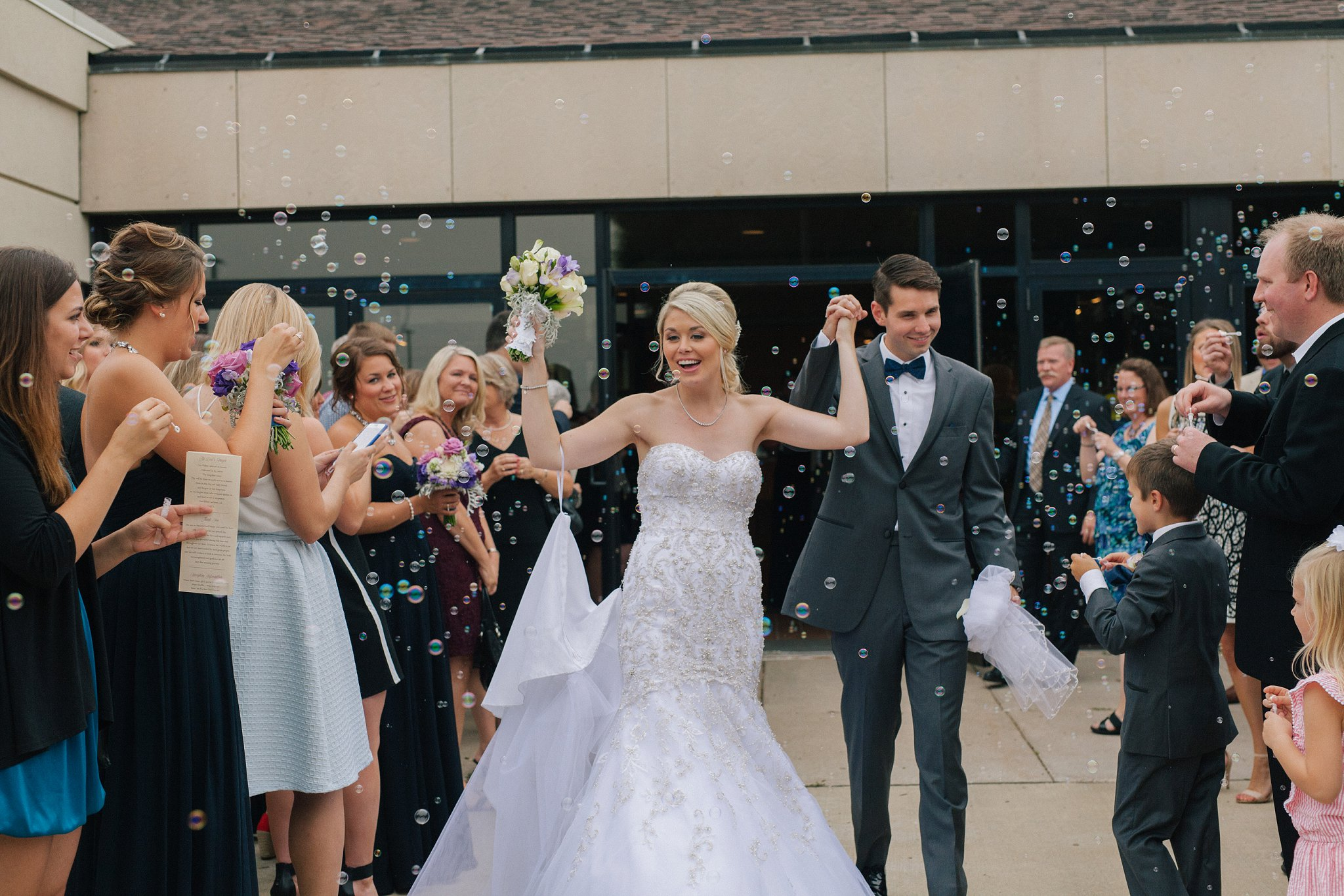 bride & groom bubble exit at St Ann's church Quad Cities
