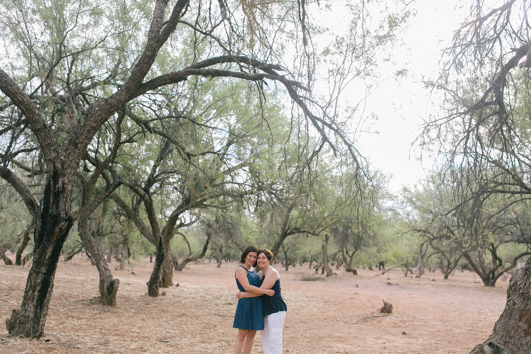 desert engagement session with two women