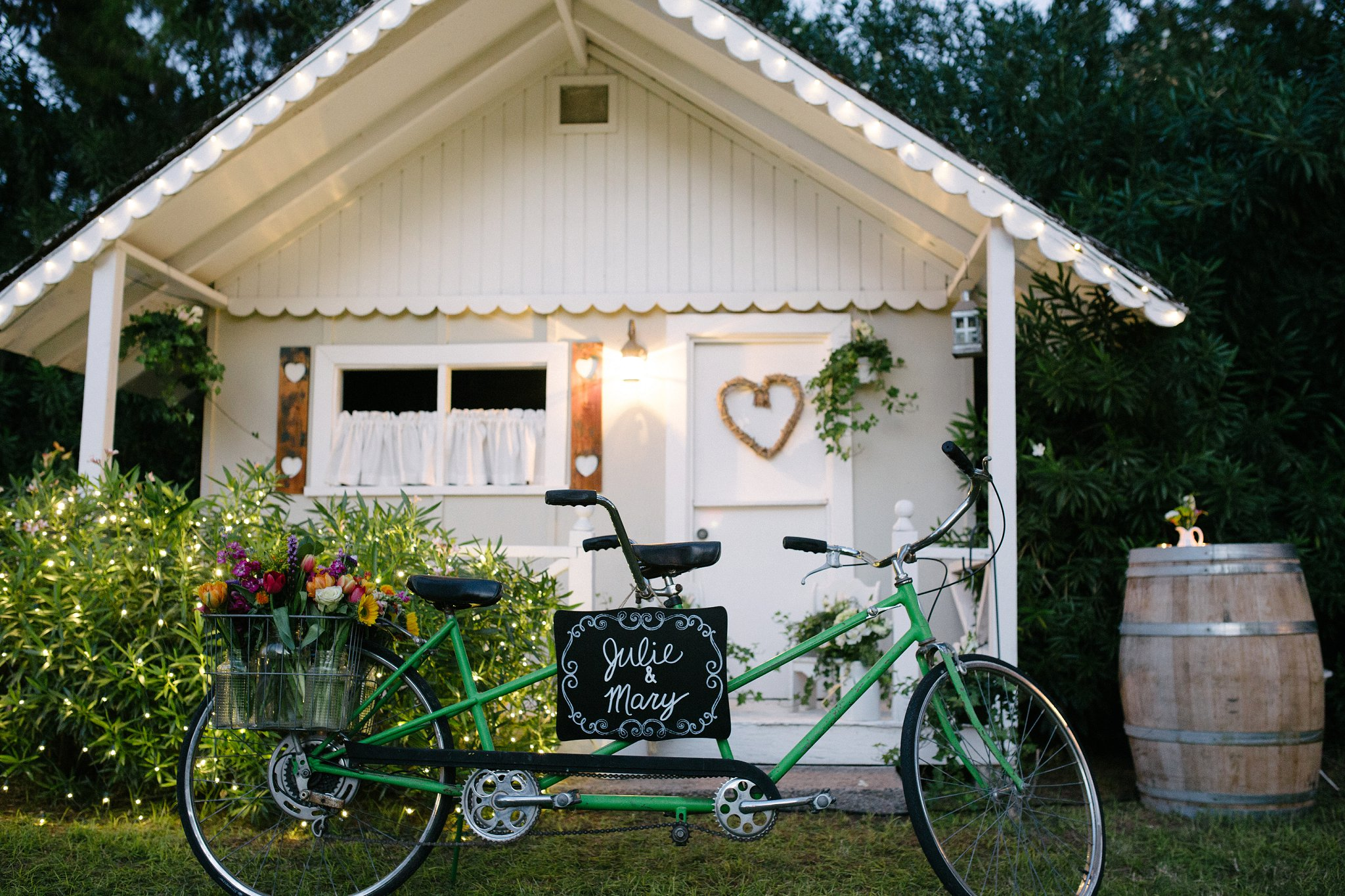 tandem bike in front of little white guest house with wedding signs in Arizona