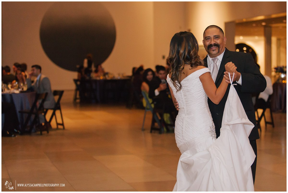 happy father dancing with bride at Phoenix Art Museum wedding