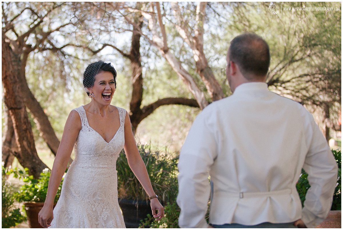 bride seeing groom for first time at Windmill Winery AZ wedding