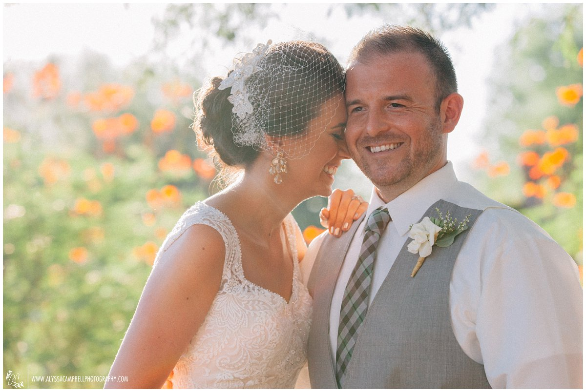 bride & groom laughing and smiling at Windmill Winery Arizona barn wedding venue