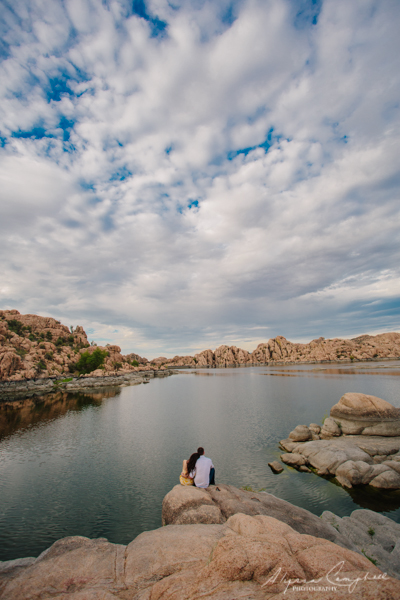 engagement photos at Watson Lake with cloudy sky