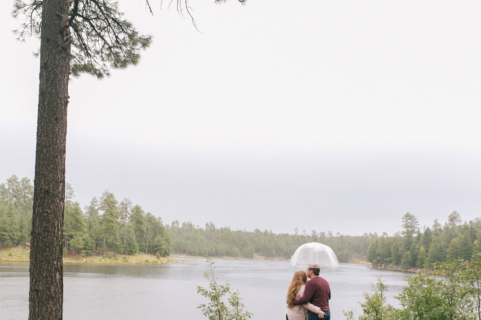 northern arizona forest engagement session in the rain
