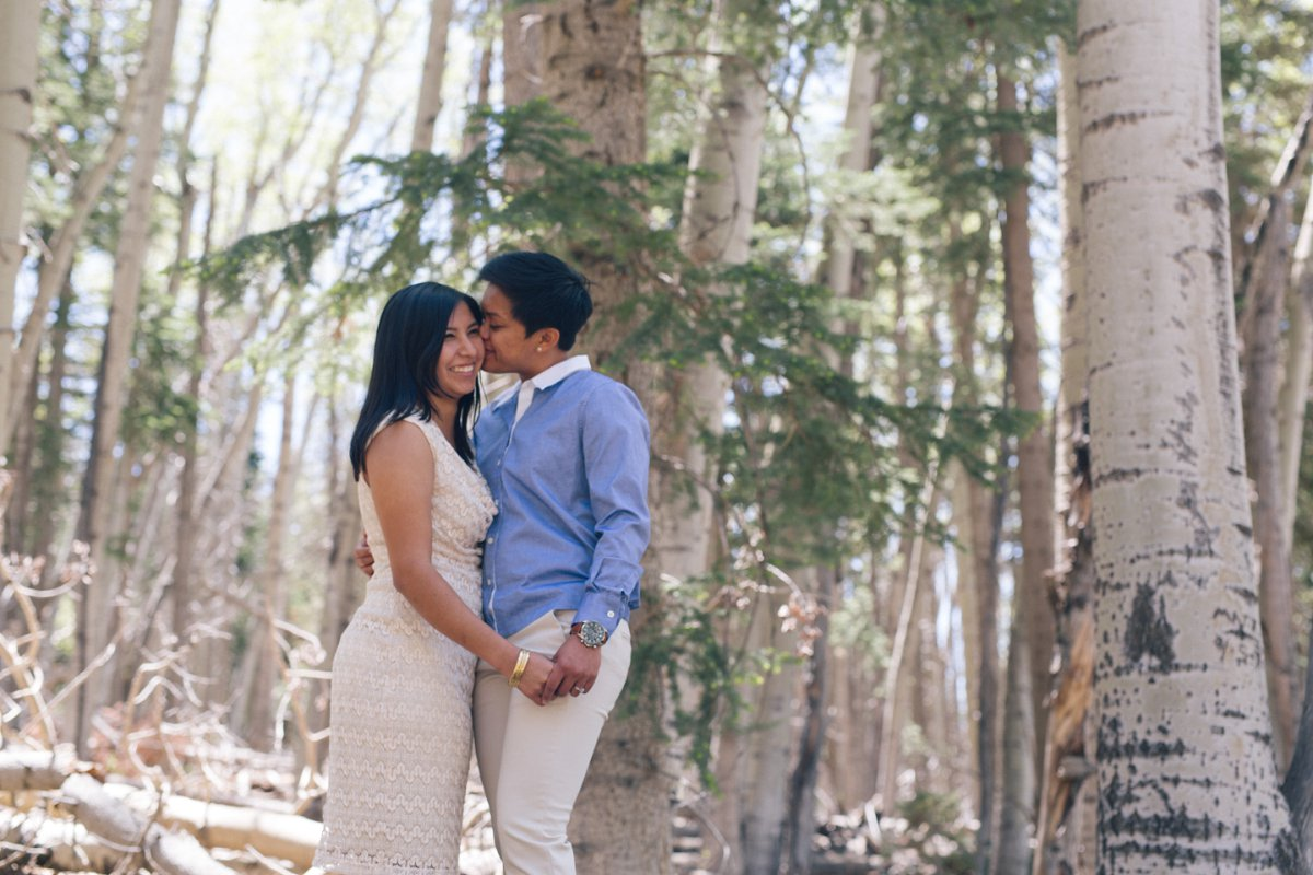 natural same sex engagement photos in Flagstaff forest