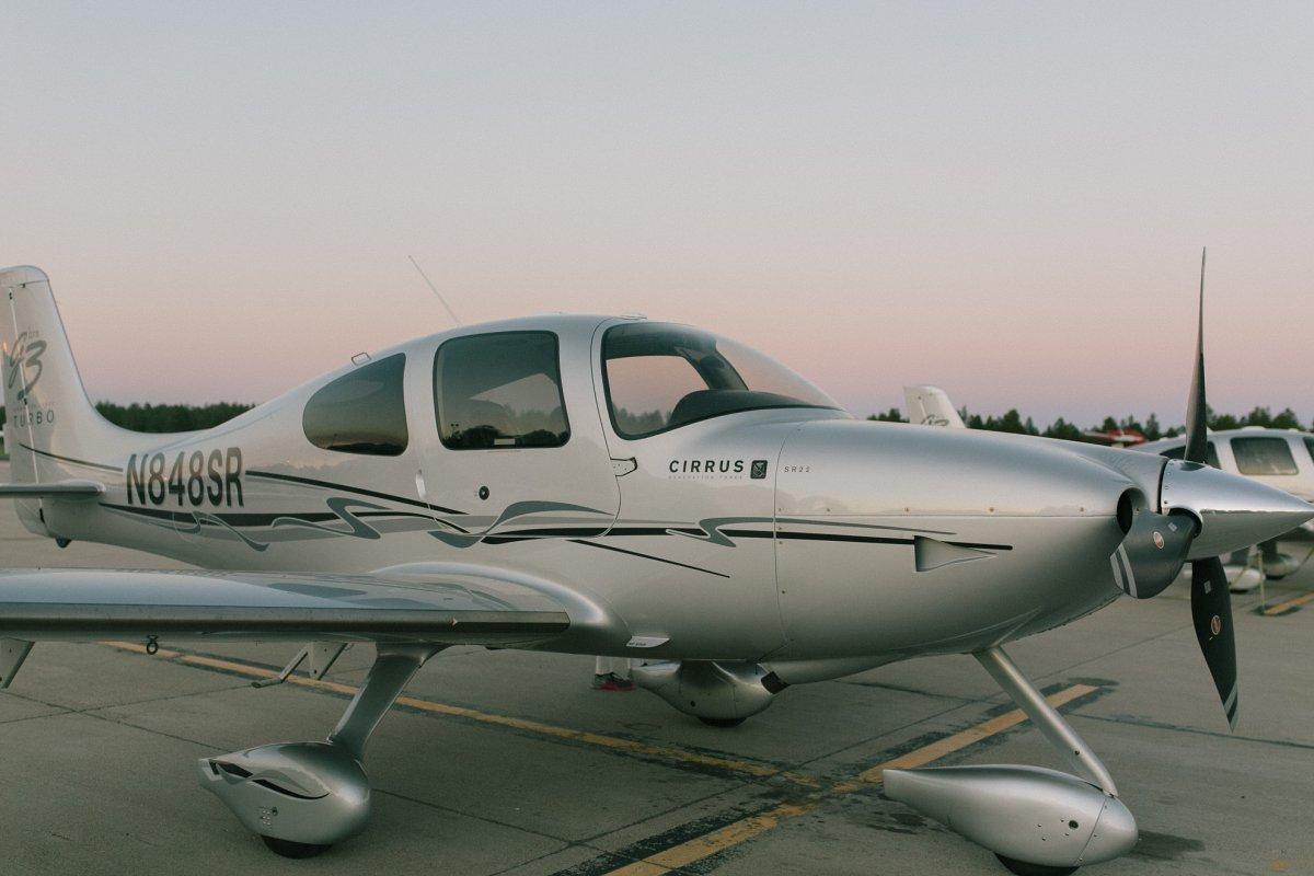 Cirrus small plane at sunset