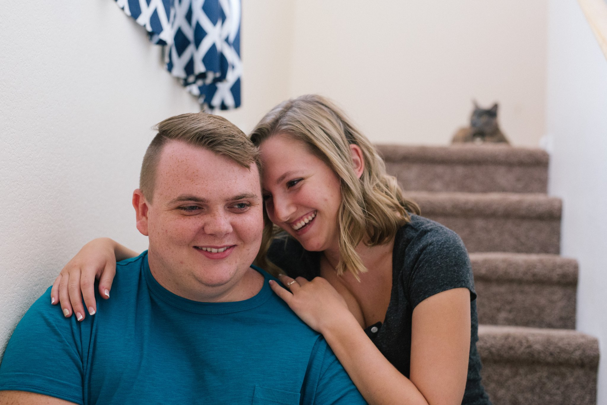 engagement photos in an apartment with a cat Tempe engagement photographer