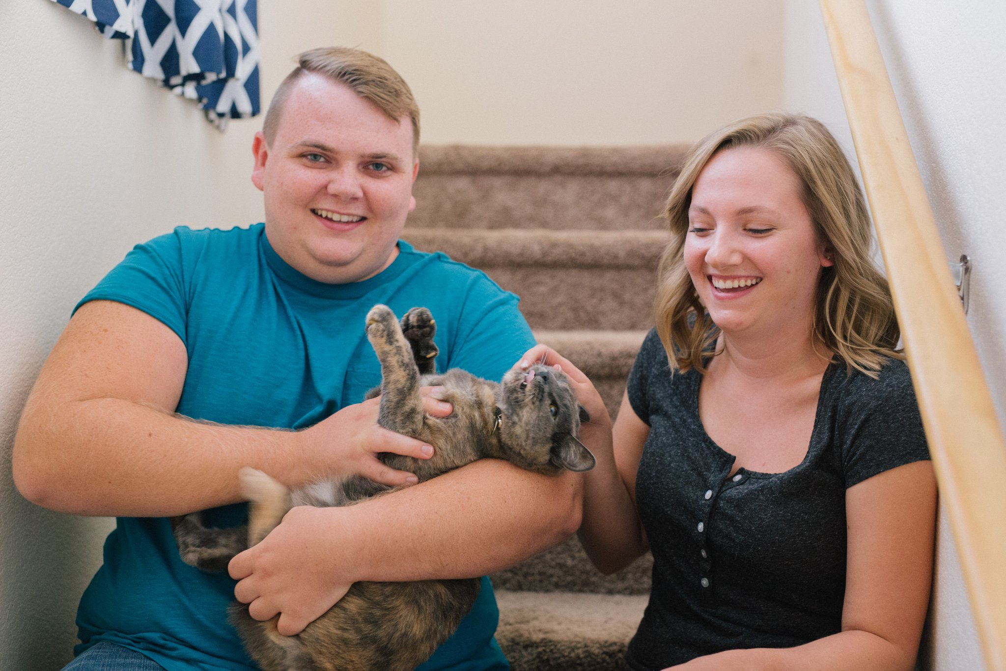 apartment engagement photos with a cat in Arizona