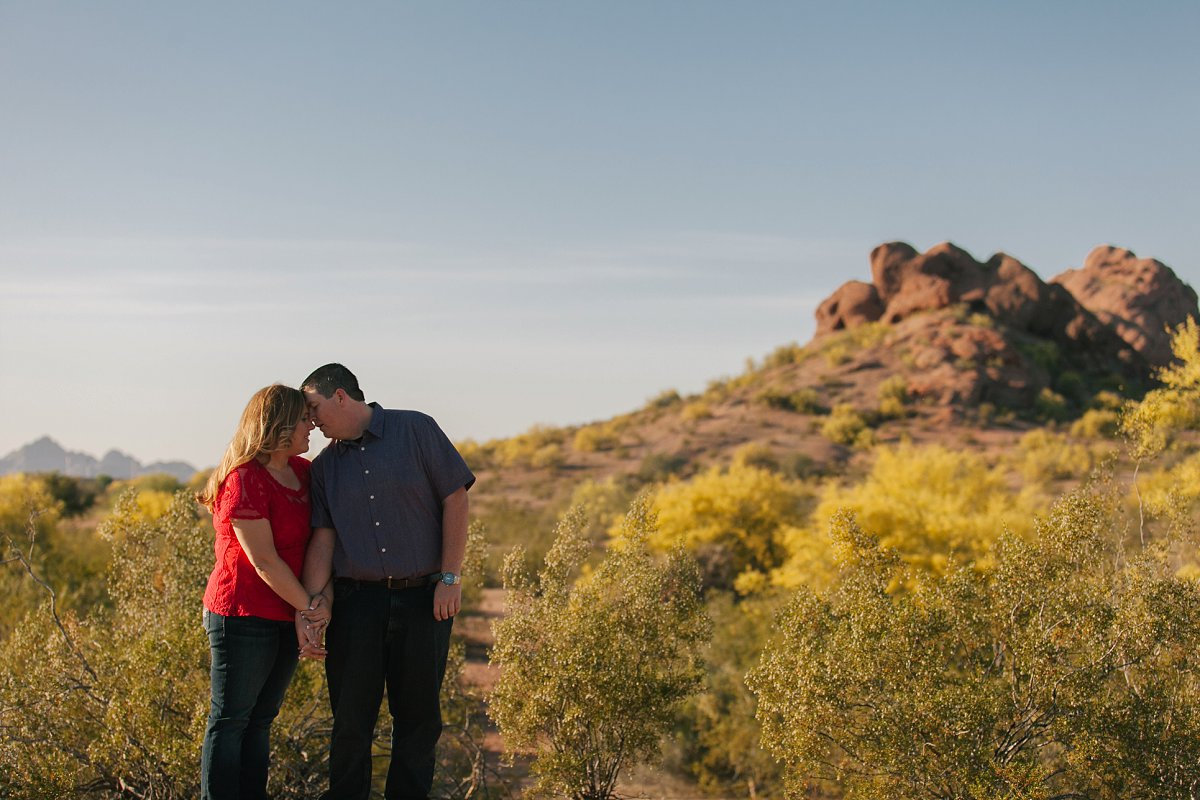 couple standing on hill overlooking Papago Park Phoenix