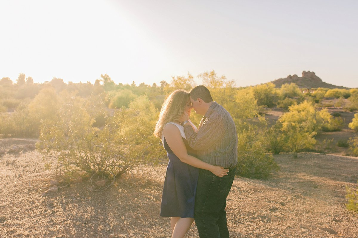candid photo of couple dancing in desert Phoenix engagement session