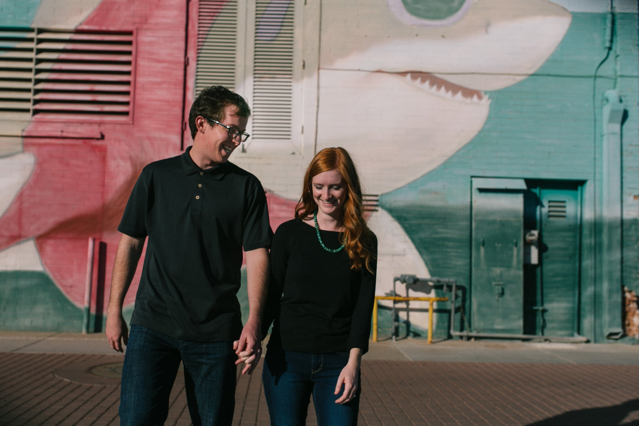 Mesa engagement photos downtown in front of shark with sunglasses mural