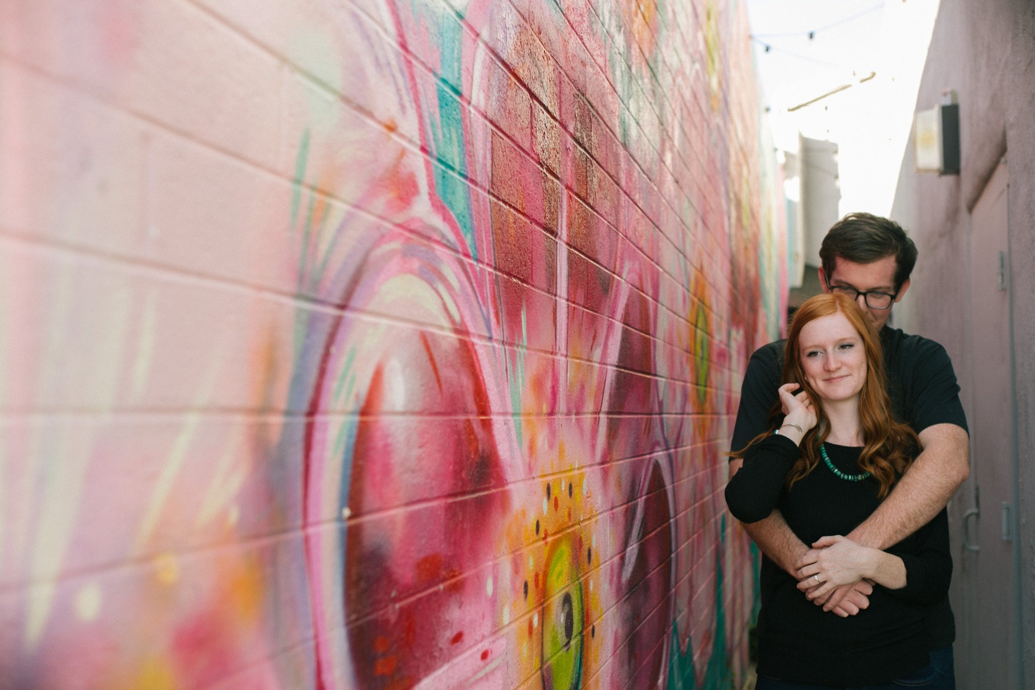 colorful floral mural downtown Mesa engagement photos