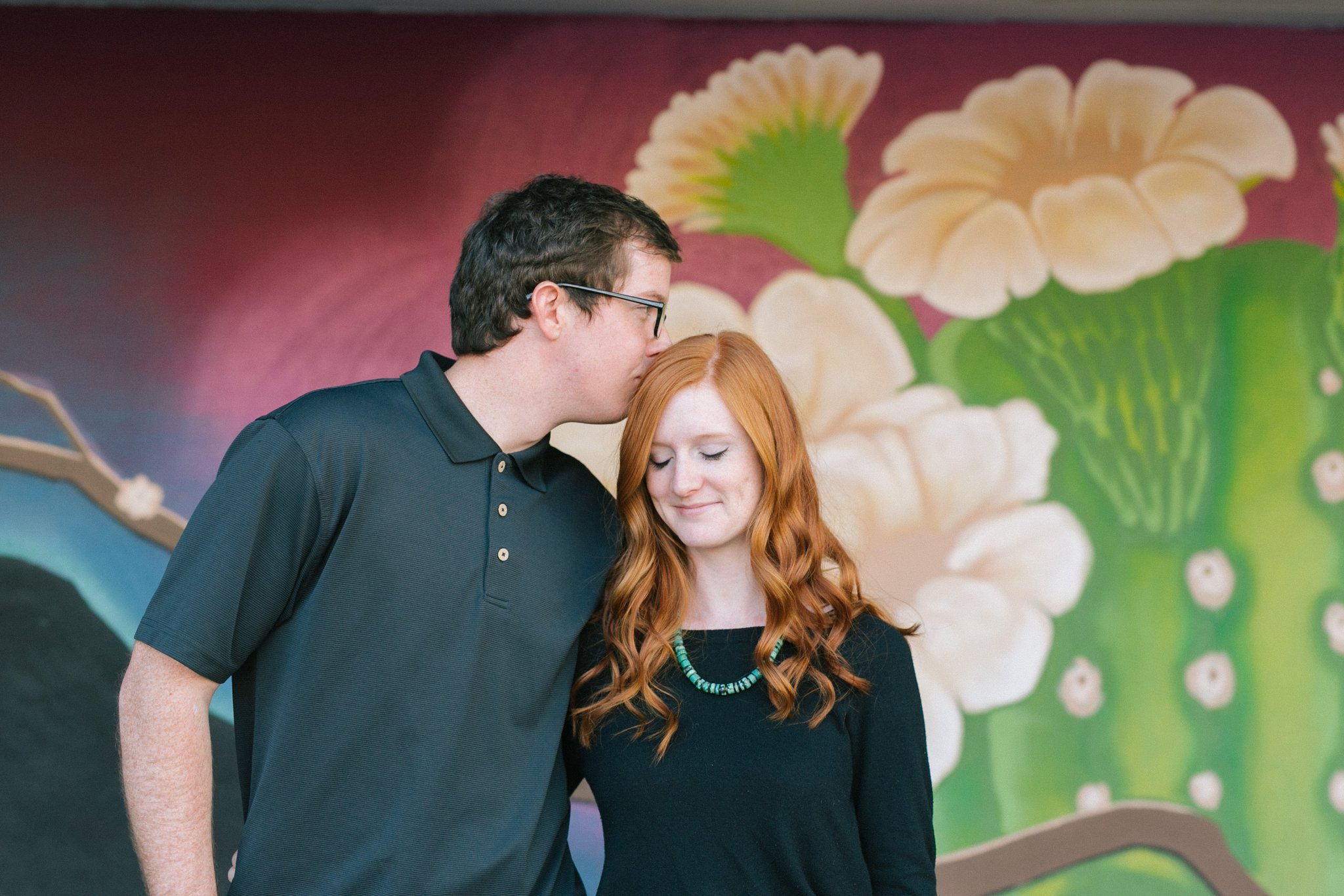 colorful desert cactus flower mural downtown Mesa engagement photographer