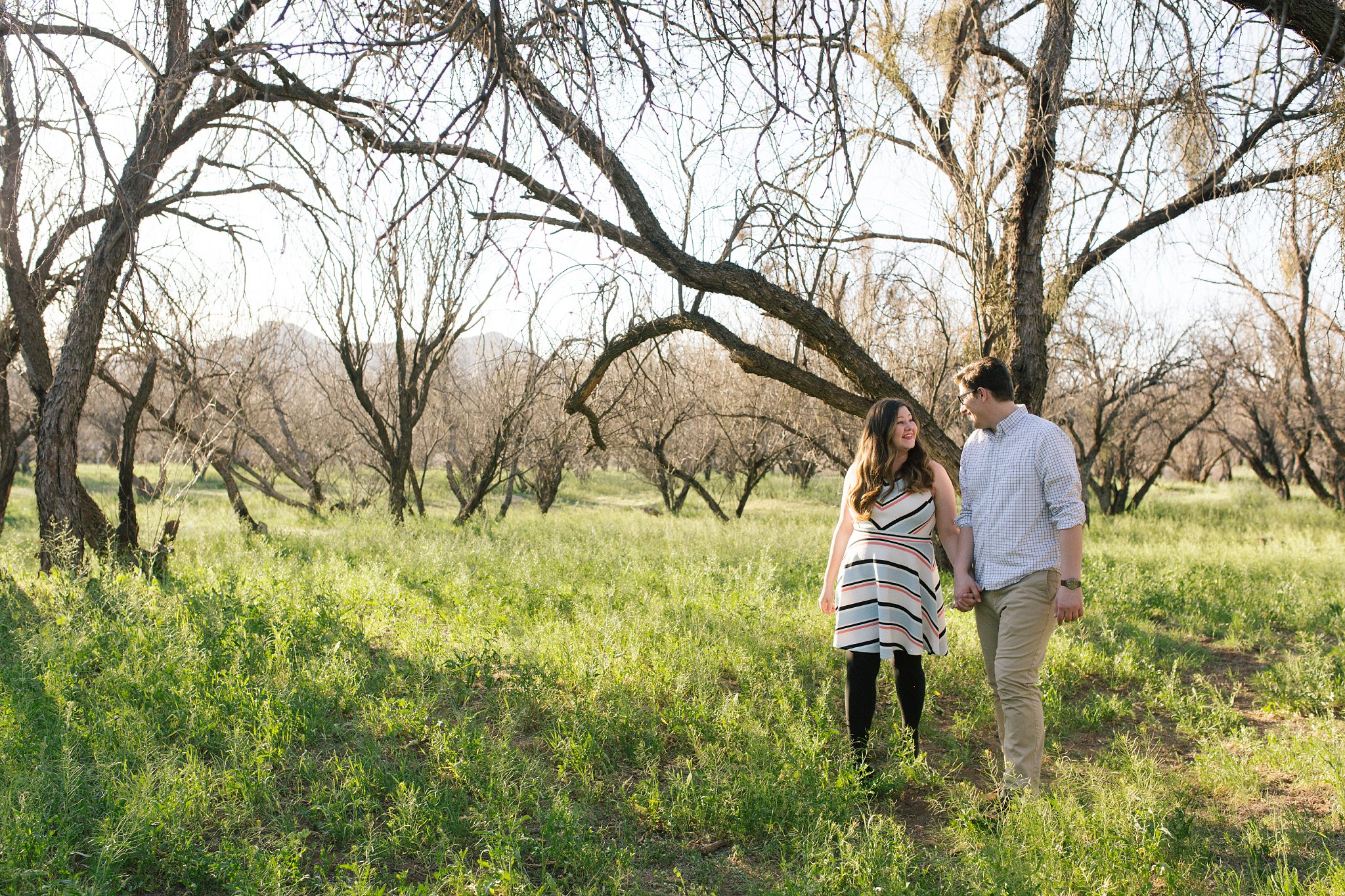 salt river engagement session in spring with grassy field