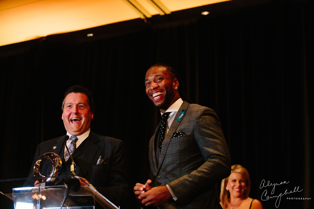Larry Fitzgerald accepting awards trophy at Teen Lifeline Connections of Hope event