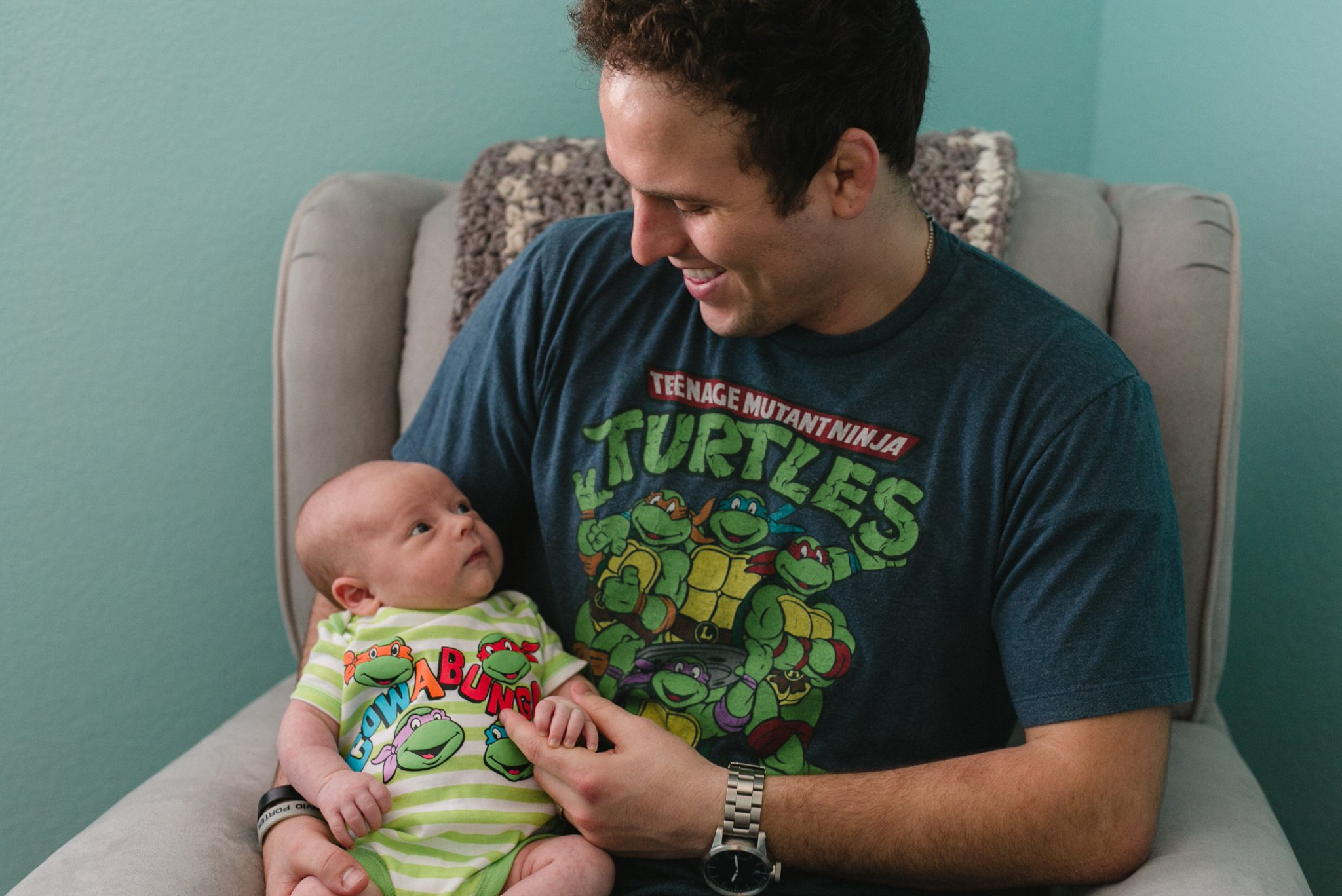 lifestyle family photos Chandler father baby matching teenage ninja turtle shirts