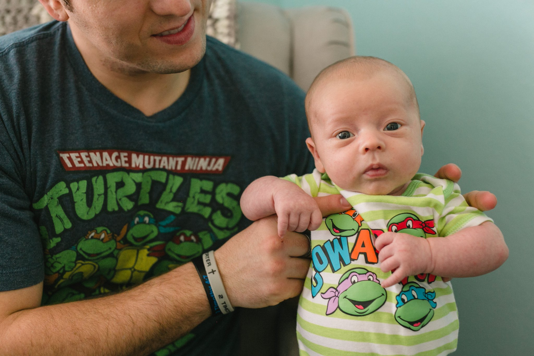 one month old baby with teenage mutant ninja turtles shirt