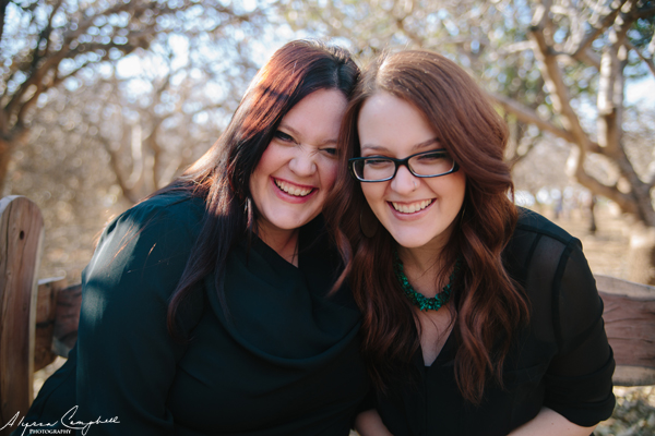adult sisters laughing together in pecan grove