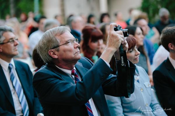 photo of grandpa taking photos at wedding ceremony