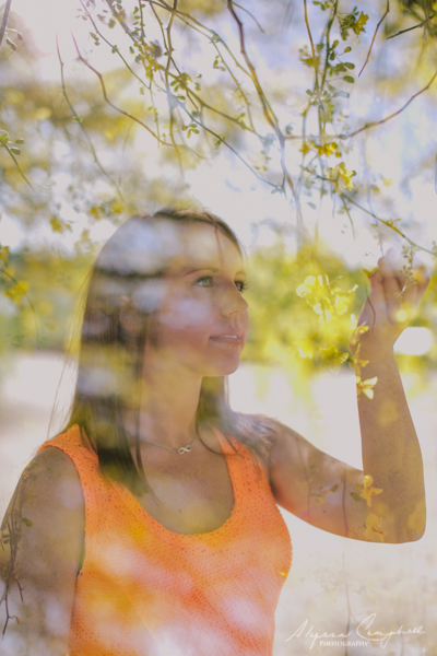 double exposure of brown haired girl and palo verde tree flowers